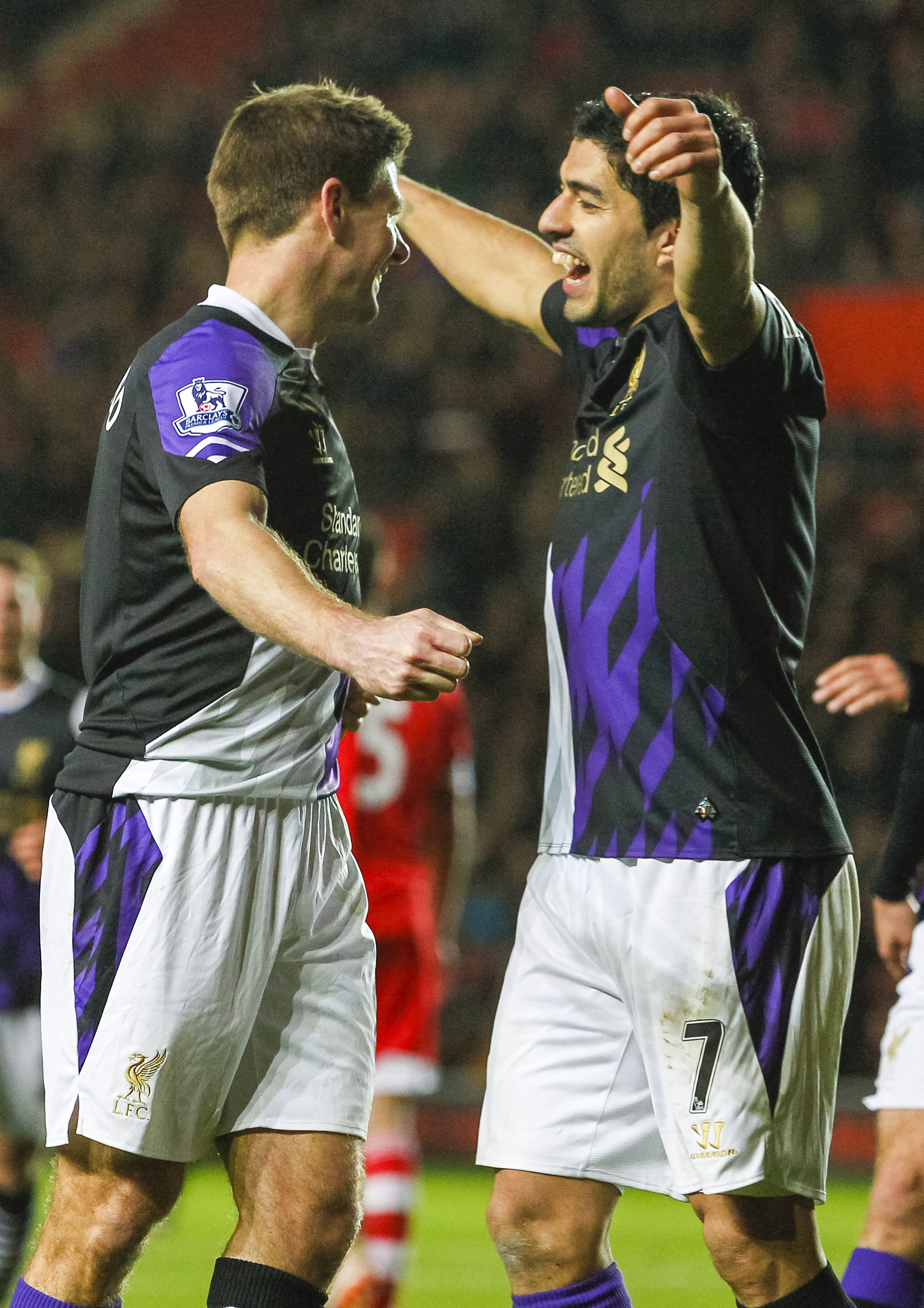 Goalscorers Steven Gerrard and Luis Suarez celebrate victory at St Mary's