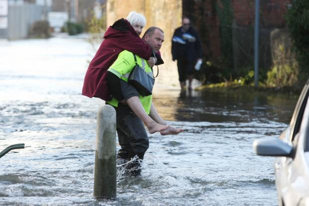 Daily Echo: Residents rescued from their flooded homes in Romsey