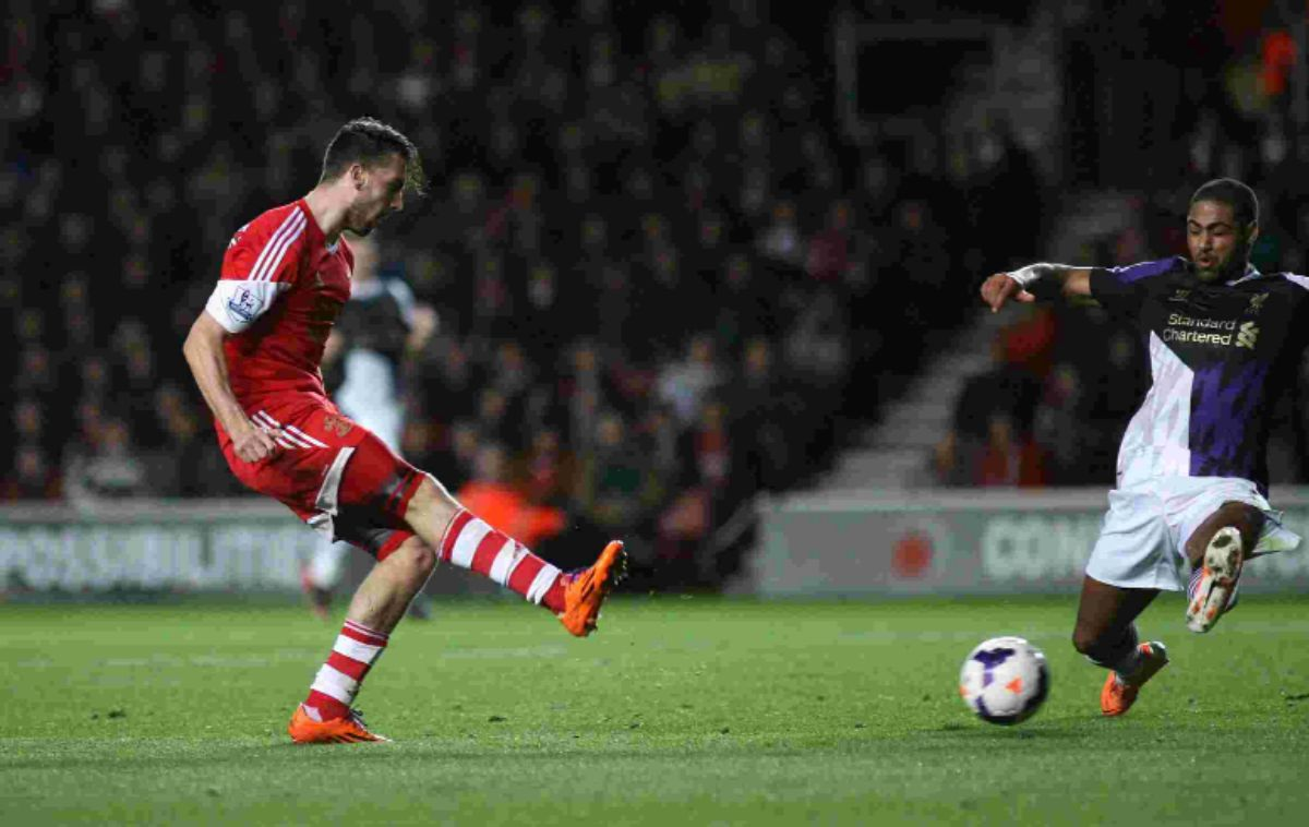 Jay Rodriguez gets in a shot against Liverpool.