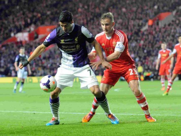 Luke Shaw watches Liverpool's Luis Suarez during the 3-0 loss at the weekend