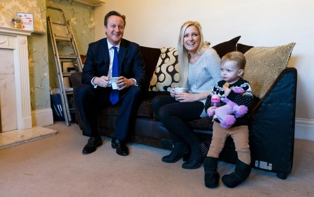 Prime Minister David Cameron has a cup of tea with Sharon Ray and her daughter Maisie, 2,  during a visit to her home in Southampton - Sharon bought her home through the government's Help to Buy scheme
