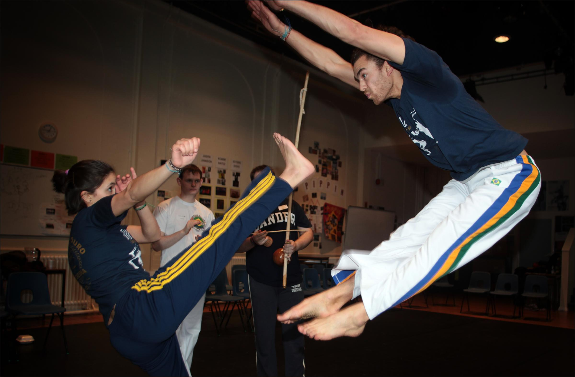 Students from Winchester University Eleanor Liverakos and Akil Morgan (front) with Tim Manthorpe and Jesse Millikin, perform Brazilian martial art Capoeira
