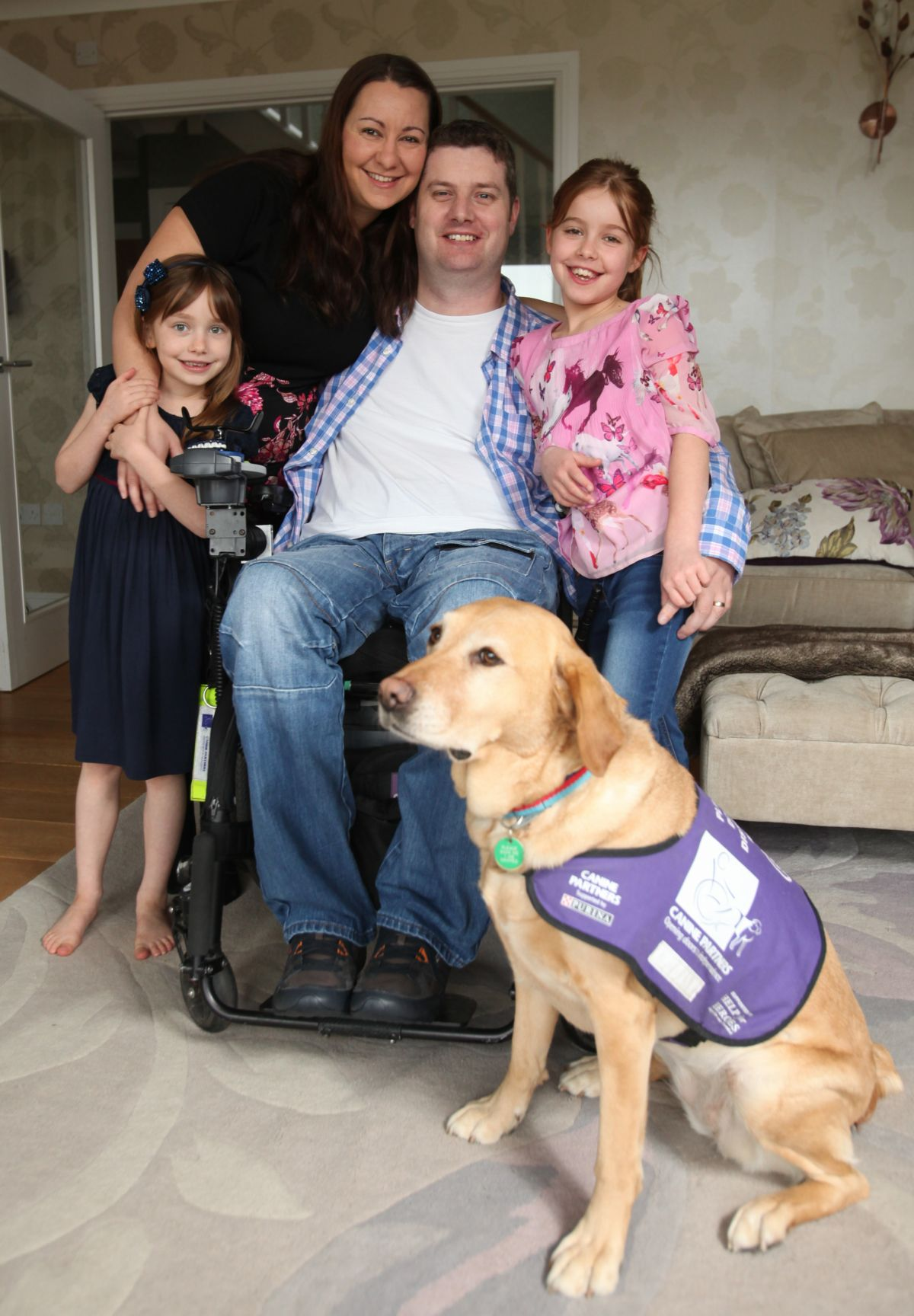 Steve with his family and Canine Partners dog Kizzie