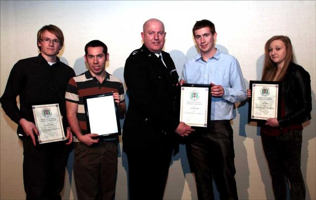Area Commander Dave Thomas presents Michael Pitchers,Michael Bland,  Christopher Bland, Kelly Surplice with their awards after their life saving endeavours on Lepe Beach.