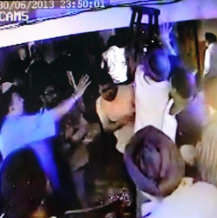 A stool is raised during a scene from the brawl captured on CCTV
