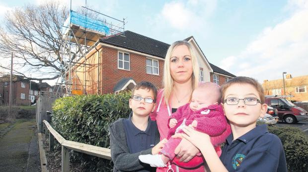 Kelly Smart, who is afraid for her children Josh 10, Lilly-Rose 3 months and Charlie 7, after tiles keep falling from the roof of their family home.