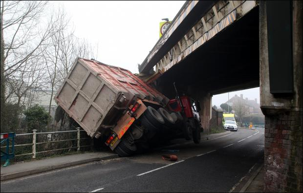 Daily Echo: The lorry which has crashed into the railway bridge in Greatbridge Road, Romsey