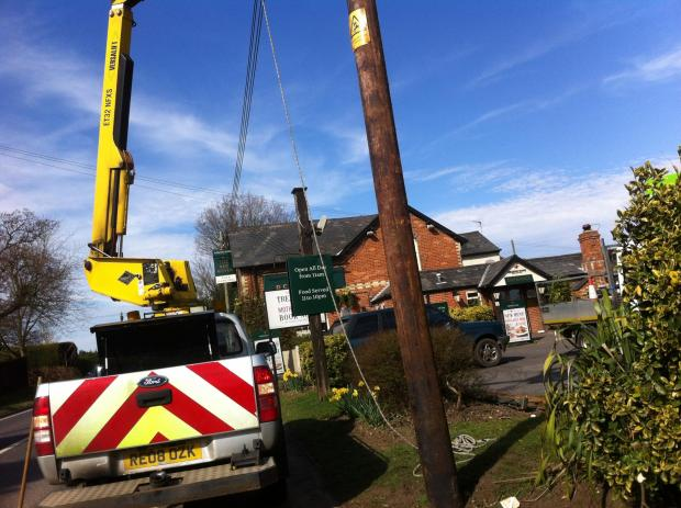Car crash smashes telegraph pole in half