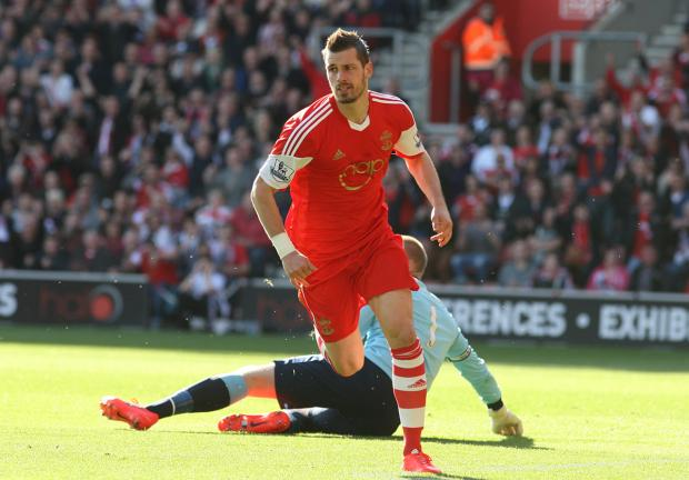 Daily Echo: Morgan Schneiderlin wheels away to celebrate putting Saints ahead against Norwich.
