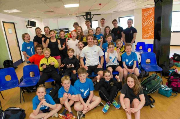 Gary Hunt, centre, with members of the South East Region Amateur Swimming Association's Talent Scheme at The Quays