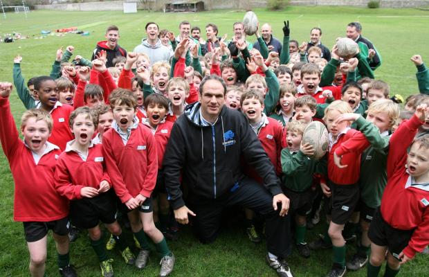 World Cup winning rugby captain Martin Johnson gives a coachin session to school