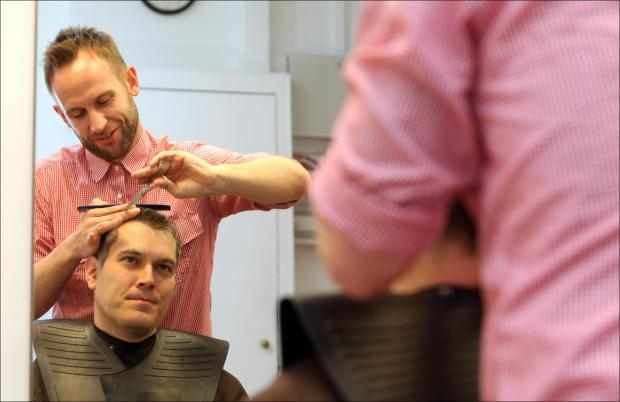 Adam Wilde gives Echo reporter Simon Walter a trim