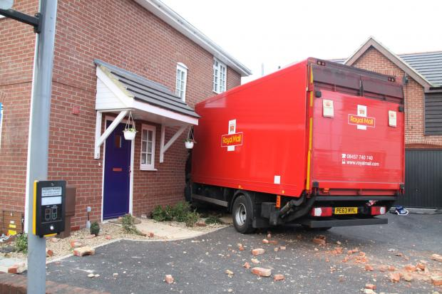 Daily Echo: The Royal Mail lorry which hit a house in Gosport this morning. Picture from HFRS