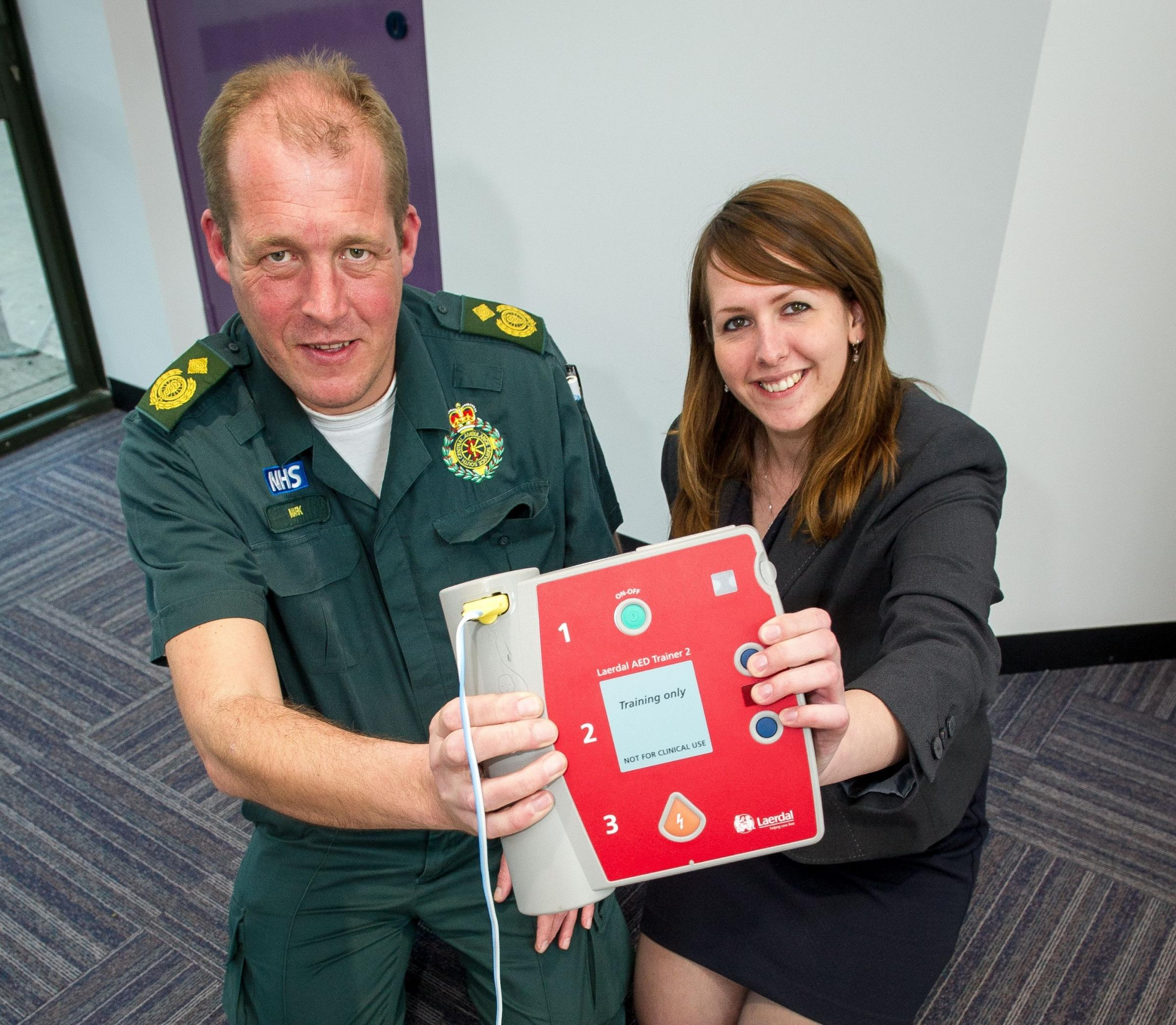 Mark Ainsworth-Smith shows Daily Echo reporter Rebecca Pearson how to use a defibrillator