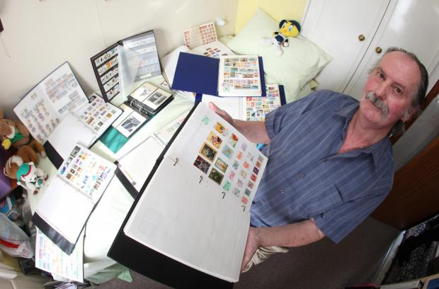 LASTING HOBBY: Brian Motteram with some of his stamps