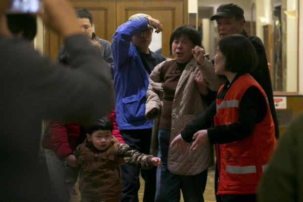 Daily Echo: Relatives of Chinese passengers aboard the Malaysia Airlines MH370 gesture after being told the latest update in Beijing, China, Monday, March 24, 2014.