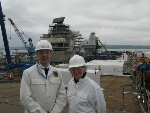 Commander Andrew Blackburn, the ship's Air Engineer Officer and Dame Mary Fagan.