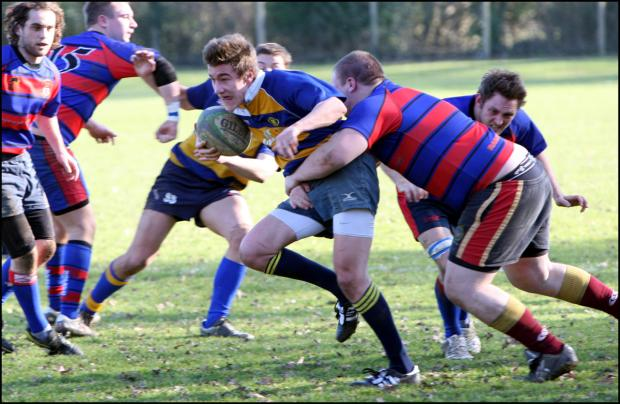 Daily Echo: TWO TRIES: Dan Penn-Newman (with ball) helped Romsey to a vital victory at Overton.