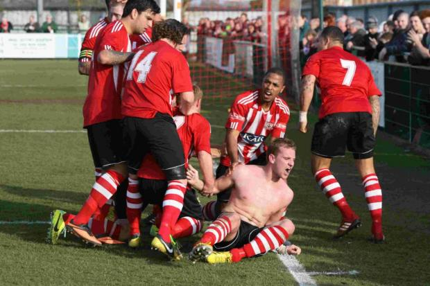 Sholing's Mike Carter (shirt off) celebrates his second-half leveller with his Sholing teammates.