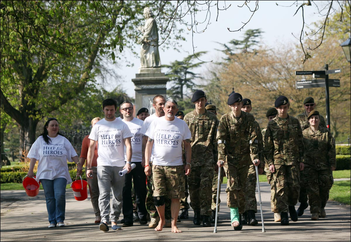 STEPPING OUT: Alan Elliot with his supporters at Southampton Cenotaph.