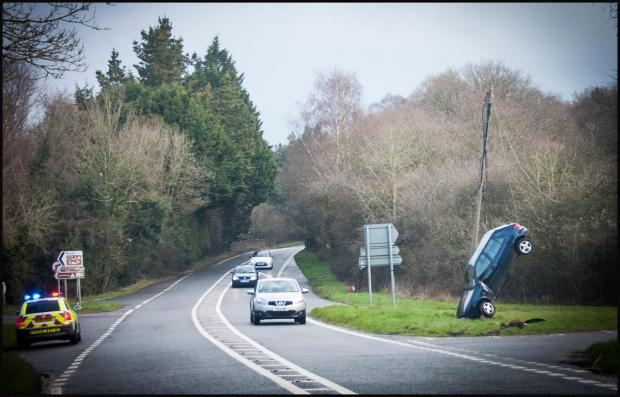Driver's remarkable escape as car hit telegraph pole