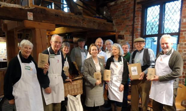 Dame Helen Ghosh (centre) with the milling team in Winchester