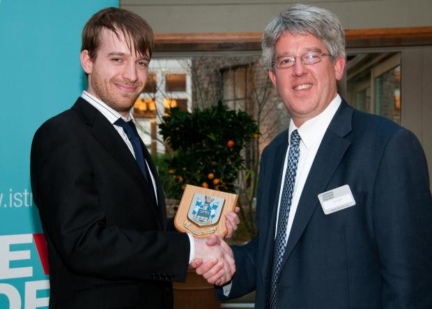 Laurence Clough receives his award from conference chairman Tim Ibell