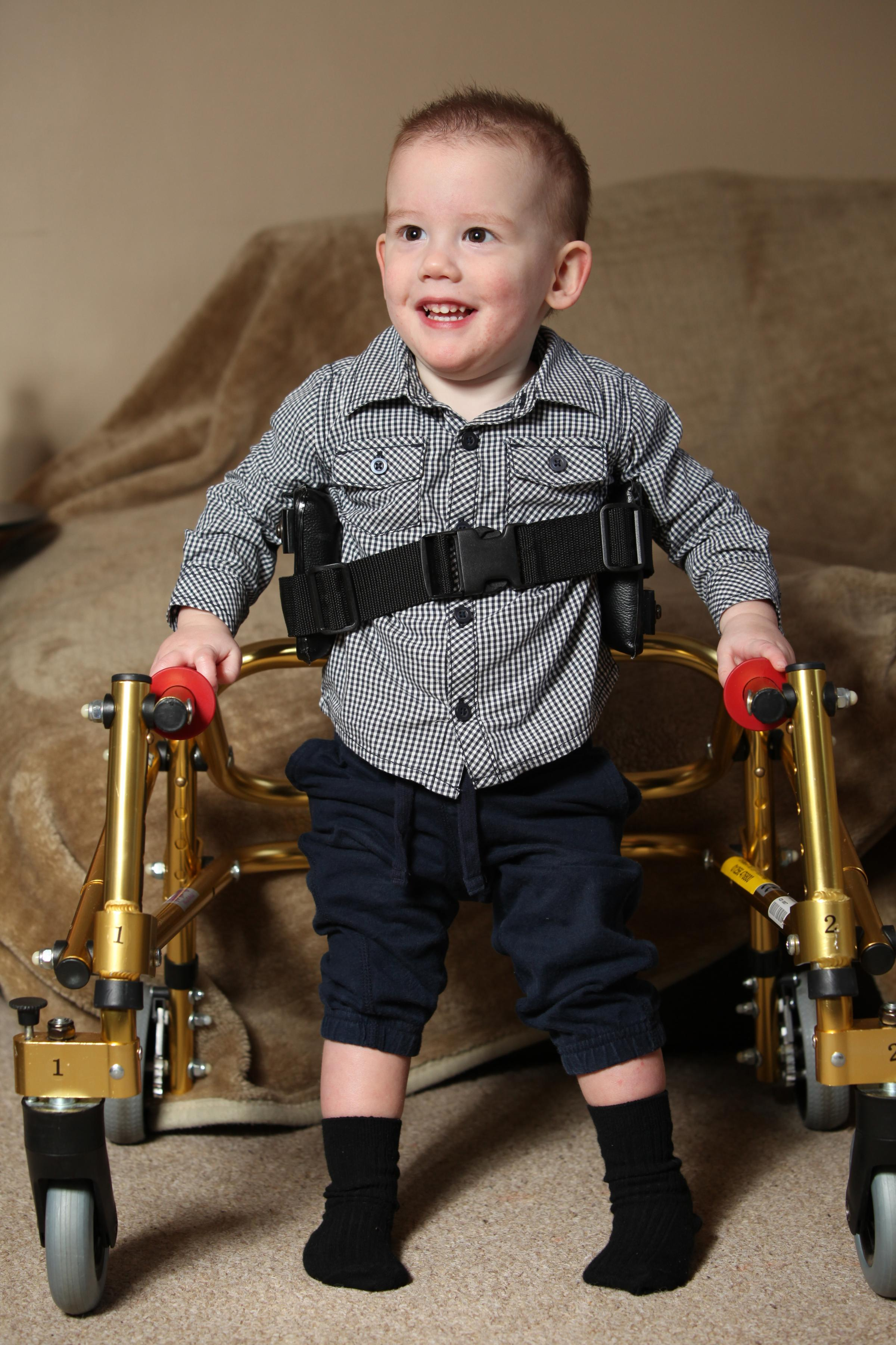 James Mills needs a £50,000 for a vital operation to help him walk