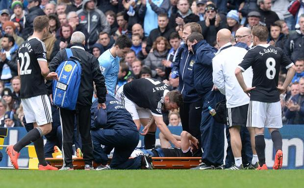 Jay Rodriguez receives treatment for his injury at Manchester City on Saturday.