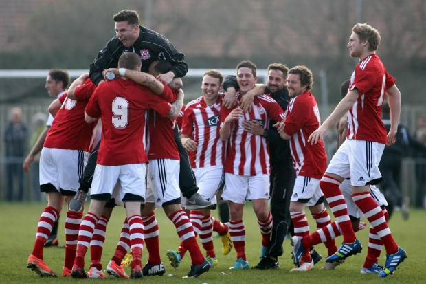Sholing players and officials celebrate their FA Vase semi-final win.