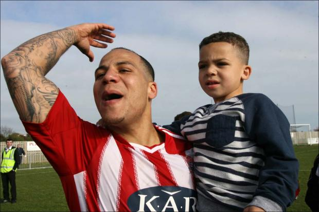 Daily Echo: Barry Mason celebrates with his son.