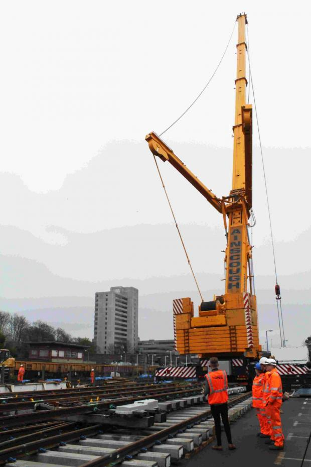 Daily Echo: The giant crane at work on the railway over the weekend.