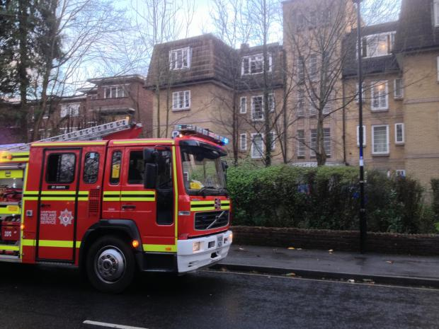 Apartment block residents evacuated after reports of fire