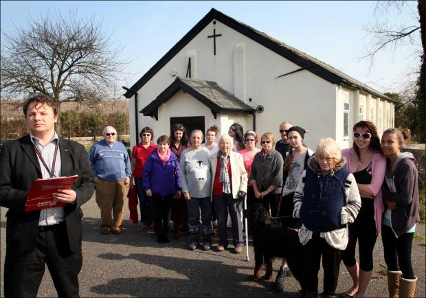 Daily Echo: Andrew Pope with local residents campaigning to save the polling station at the St George's Centre in Calshot.