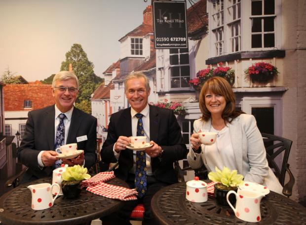 Daily Echo: Dr Hilary Jones, centre, with Colten Care chairman Ian Hudson and home manager Jackie Hampton.