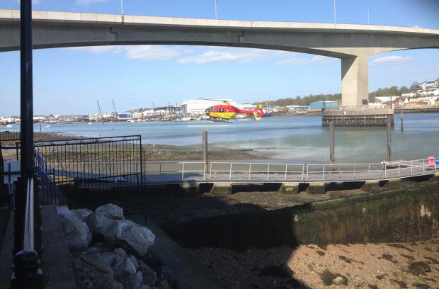 Daily Echo: Hampshire & Isle of Wight Air Ambulance lands near the Itchen Bridge. Picture by Fraser Moule