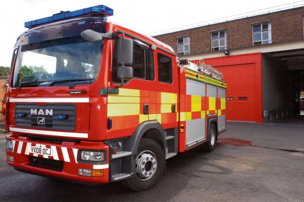 Crews tackle outbuilding fire