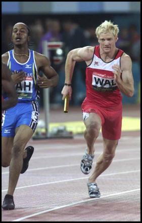 Iwan Thomas competing at the Commonwealth Games in 2002.