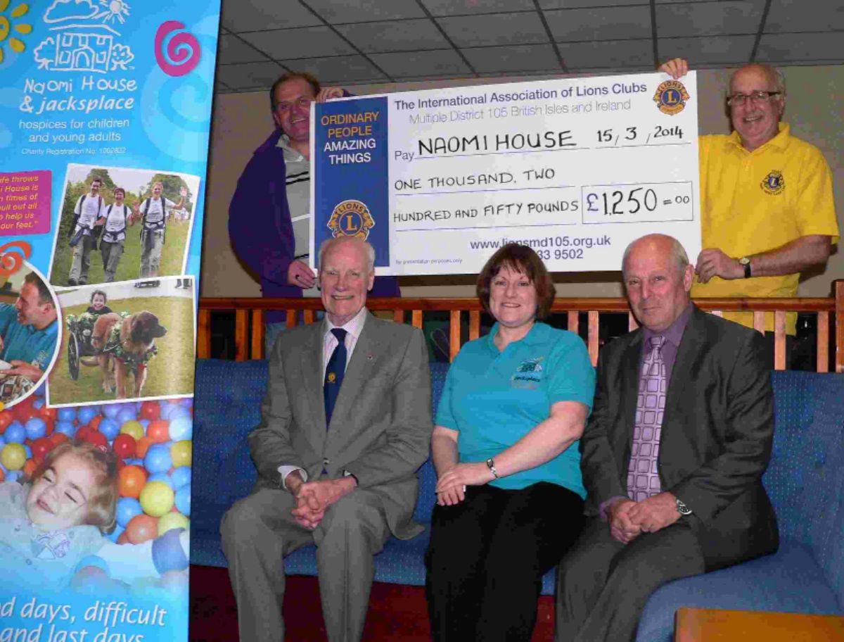 Fords Sports SAC present Naomi House officials with a cheque for £1,250. Front (from left)