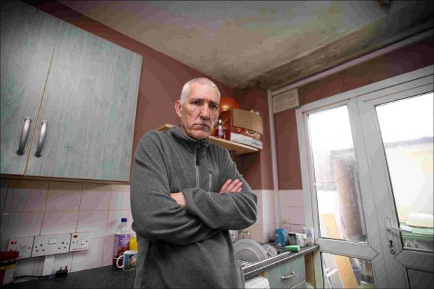 Ivan Vanderstichele is angry about the state of his council house, including his mouldy kitchen