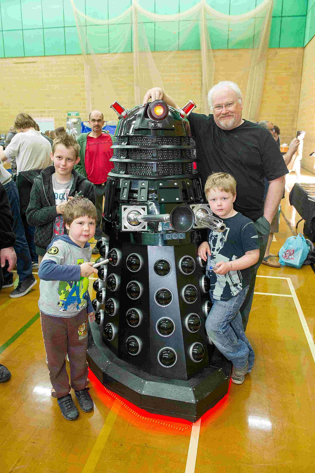 Dr Who Number Six, actor Colin Baker, with young fans Reece, Ethan and Tommy