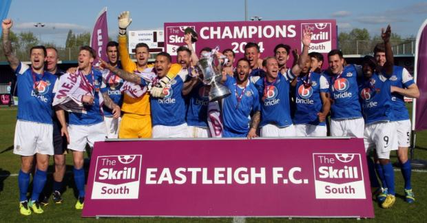 Eastleigh players celebrate their promotion