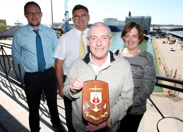 Clive Curtis, front, receives the crest of the Port of Southampton from ABP director Nick Ridehalgh, left, with his wife Debbie and operations director Stuart Marsh
