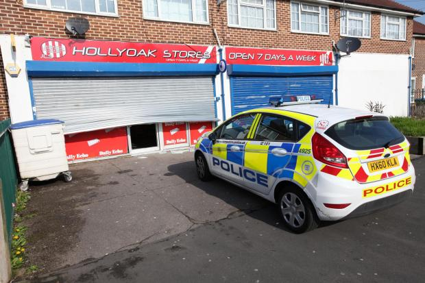 Police at Hollyoak Stores in Holly Oak Road after the theft