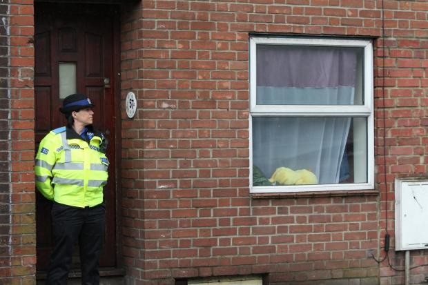 Police outside a property in St Denys yesterday