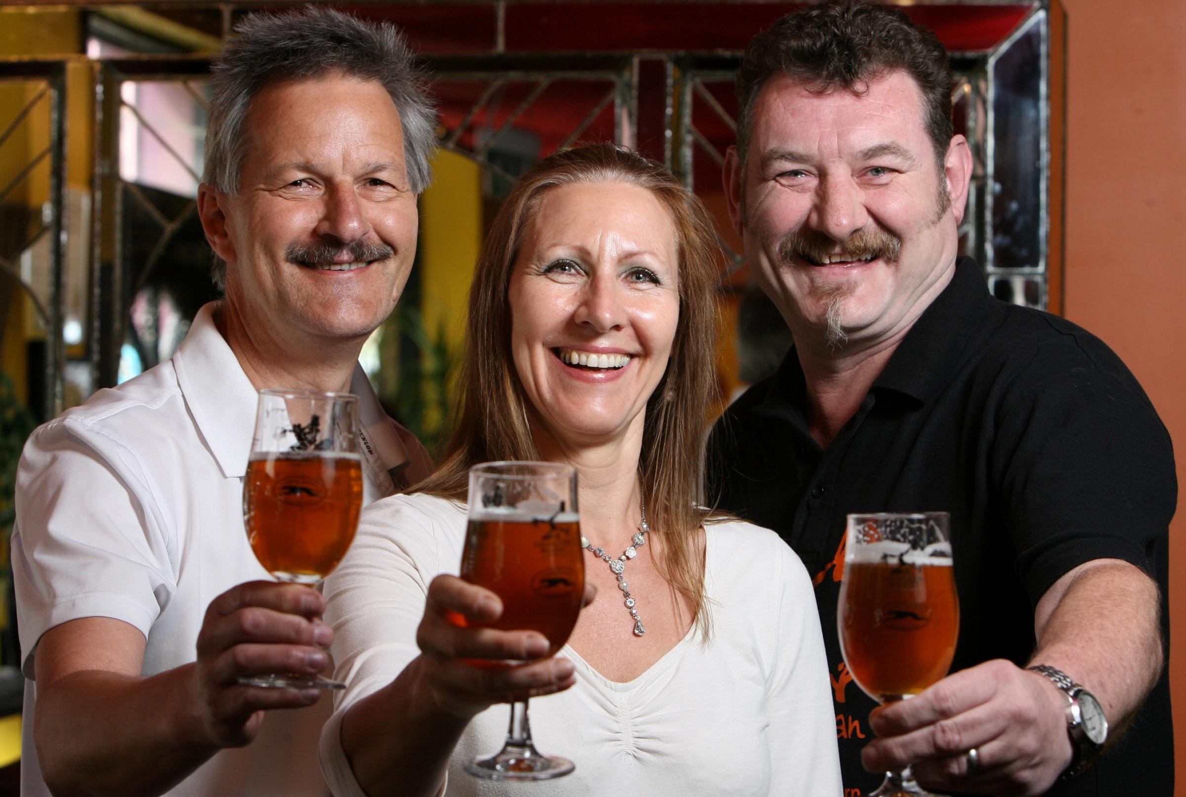 CHEERS: From left,Trevor and Jenny Moore with Dancing Man Brewery's Stewart Cross trying the new tipple. Echo picture by Chris Moorhouse. Order no: 18377691