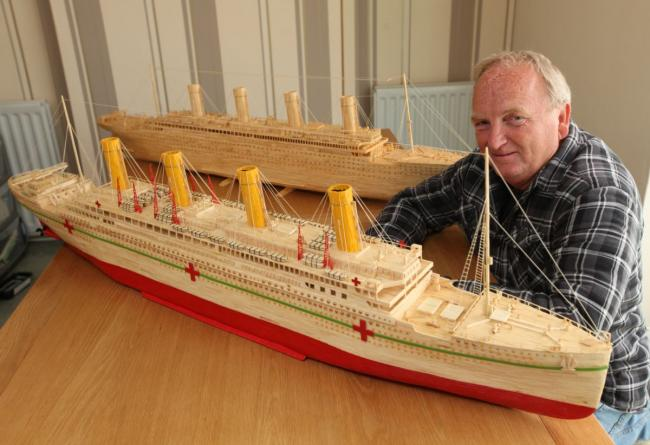 Dave Reynolds with his matchstick model of HMHS Britannic pictured next to his model of Titanic.