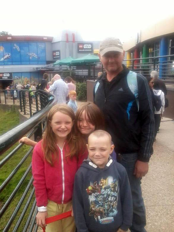Andrew Rodick, pictured at Legoland with his children