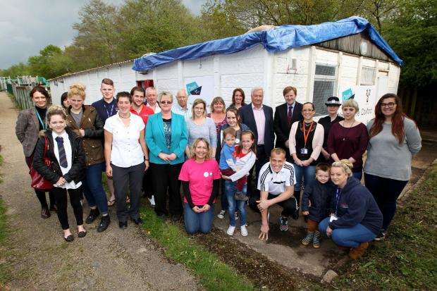 Volunteers and youngsters celebrate the reopening of the Olive Road youth centre