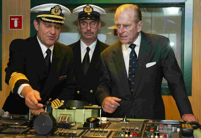ON THE BRIDGE: The Duke of Edinburgh with Captain Paul Wright and chief engineer Brian Whattling, during his tour of the QM2 ten years ago.